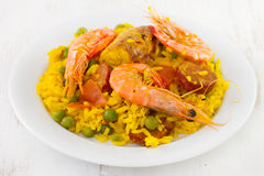 Paella on white plate Stock Photo