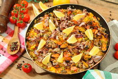 Paella on wooden table Royalty Free Stock Images