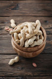 Paenut in the bowl in the wooden table Royalty Free Stock Photography
