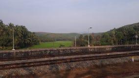 Paesaggio ad una stazione ferroviaria Fotografia Stock Libera da Diritti