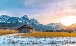 Paesaggio alpino al tramonto di inverno Fotografia Stock