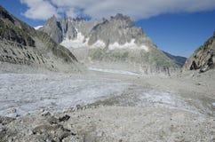 Paesaggio alpino con le montagne ed il ghiacciaio Fotografia Stock