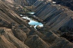 Paesaggio con il lago nella miniera Fotografia Stock