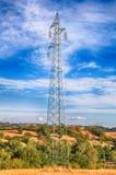 Paesaggio con le linee ad alta tensione della torre Fotografie Stock Libere da Diritti