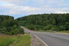 Paesaggio con una strada rurale Immagini Stock Libere da Diritti