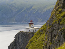 Paesaggio del mare con un falò Fotografie Stock Libere da Diritti