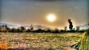 Paesaggio del villaggio della tribù al tramonto, Poli, Camerun di fulani di Mbororo aka Fotografia Stock Libera da Diritti