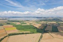 Paesaggio del villaggio sopra le nubi Fotografia Stock