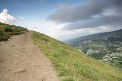 Paesaggio dell'alta montagna Cielo drammatico Immagini Stock