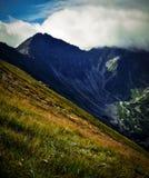 Paesaggio dell'alta montagna in nuvole Fotografia Stock Libera da Diritti