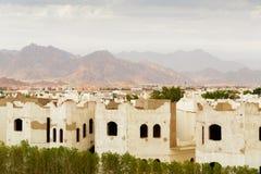 Paesaggio della città con le case di qualità inferiore nell'Egitto Fotografia Stock