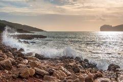 Paesaggio della costa del capo Caccia al tramonto Fotografie Stock Libere da Diritti