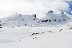 Paesaggio della montagna con neve. Immagini Stock