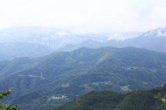 Paesaggio della montagna nella foschia Immagini Stock Libere da Diritti