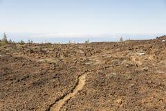 Paesaggio della roccia della lava della depressione del percorso Fotografie Stock Libere da Diritti