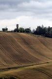 Paesaggio delle colline con la torre di acqua Fotografia Stock Libera da Diritti