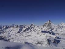 Paesaggio delle montagne della neve Fotografie Stock