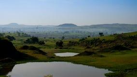 Paesaggio di agricoltura con gli stagni ed i campi del tef in Etiopia Fotografia Stock Libera da Diritti
