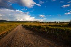 Paesaggio di colore della strada non asfaltata Fotografia Stock