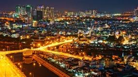 Paesaggio di notte dell'impressione della città dell'Asia Immagini Stock
