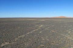 Paesaggio di pietra grigio del deserto Fotografie Stock
