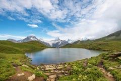 Paesaggio fantastico con il lago nelle alpi svizzere, Europa Wetterh Immagine Stock Libera da Diritti