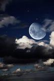 Paesaggio fantastico di notte con la grande luna Immagini Stock