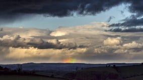 Paesaggio lunatico con l'arcobaleno Immagine Stock