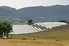Paesaggio in marzo con i comitati solari Fotografia Stock Libera da Diritti