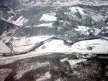 Paesaggio rivestito della neve aerea Immagini Stock