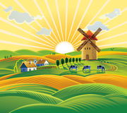 Paesaggio rurale con un mulino a vento Fotografie Stock Libere da Diritti