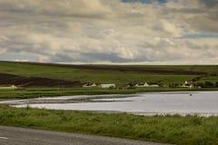 Paesaggio rurale intorno all'anello del cerchio di pietra neolitico di Brodgar Fotografia Stock