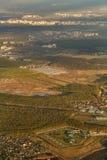 Paesaggio urbano dall'aeroplano Immagine Stock