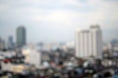 Paesaggio urbano Defocused di una metropoli durante la luce di giorno Fotografia Stock