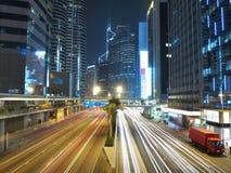 Paesaggio urbano di Hong Kong alla notte Immagini Stock