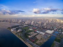 Paesaggio urbano di Manila, Filippine Bay City, area di Pasay Grattacieli nel fondo Fotografia Stock