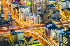 Paesaggio urbano di Nagoya nella notte nella vista dello zoom del teleobiettivo Immagine Stock Libera da Diritti