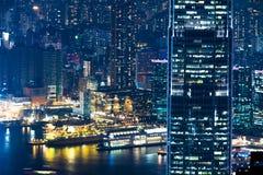 Paesaggio urbano futuristico astratto di notte Vista di Hong Kong Fotografie Stock Libere da Diritti