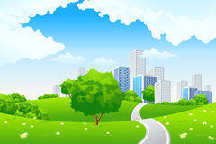 Paesaggio verde con la città Fotografia Stock