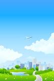 Paesaggio verde con la città Fotografie Stock