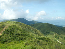 Paesaggio verde della montagna il giorno Immagine Stock