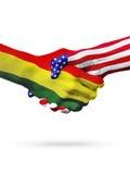 Paesi delle bandiere Bolivia e degli Stati Uniti, stretta di mano ristampata Fotografia Stock