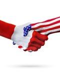 Paesi delle bandiere Perù e degli Stati Uniti, stretta di mano ristampata immagine stock libera da diritti