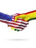 Paesi delle bandiere Stati Uniti e della Bolivia, stretta di mano di associazione Fotografie Stock
