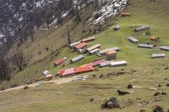 Paesino di montagna con i tetti variopinti Fotografia Stock