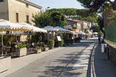 Paestum shops. Paestum Archaeological UNESCO World Heritage Site, road along the area of the temples, with souvenir shops bars and restaurants, Campania, Italy stock image
