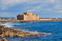 Pafos Harbour Castle in Cyprus on a bright day with clouds Royalty Free Stock Images