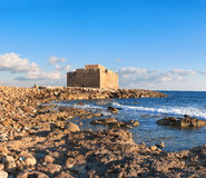 Pafos Harbour Castle in Cyprus late afternoon with clouds Royalty Free Stock Photos