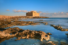 Pafos Harbour Castle in Pathos, Cyprus on a sunset Royalty Free Stock Images