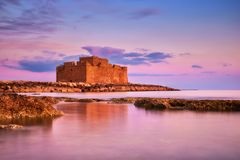 Pafos Harbour Castle in Pathos, Cyprus, on a sunset Stock Images